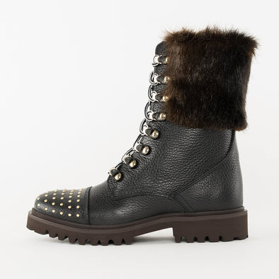 Mid-sheen combat boots in black full-grain leather with golden tacks on the toe cap, black fur panel in the sheen and track sole