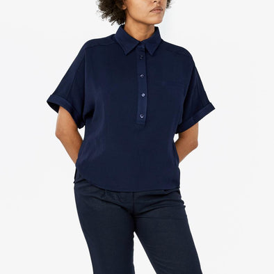 Polo with raglan sleeves and chest pocket.