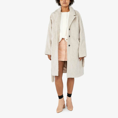 Belted faux fux coat with side pockets.