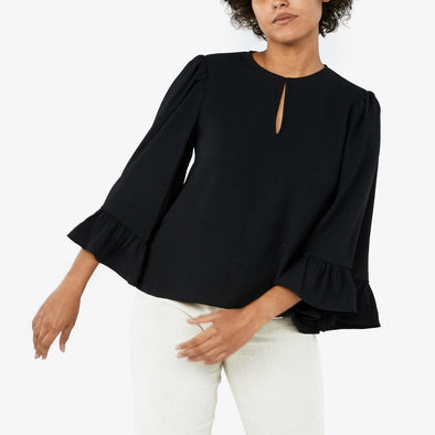 Longsleeve with ruffles blouse with front detail opening.