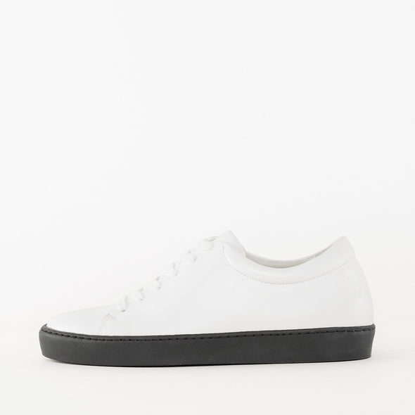 Lace-up sneakers in white leather with black rubber sole