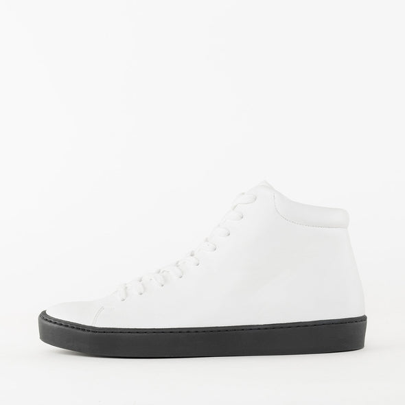 Lace-up high-top sneakers in white leather with black rubber sole