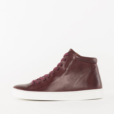 High top lace-up sneakers in bordeaux leather with white rubber sole