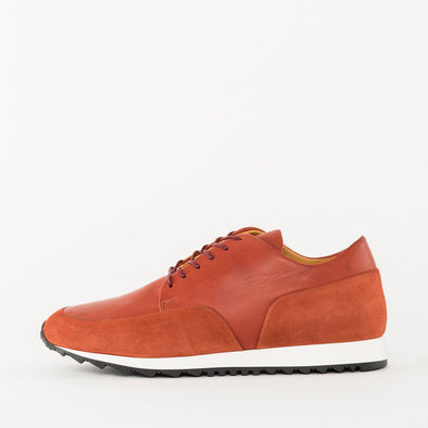 Minimalist lace-up runners in brick red leather with nubuck panels and white rubber sole