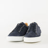Low top lace up sneakers in navy blue scale-textured suede with white rubber sole and white leather heel tab