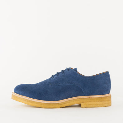 Minimalist derby shoes in cobalt blue suede with contrasting chunky crepe sole.