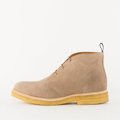 Minimalist chukka boots in beige suede with contrasting chunky crepe sole.