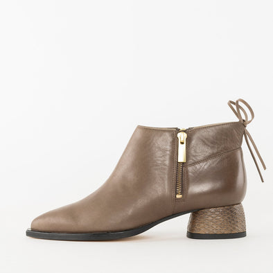 Pointed toe booties in taupe leather with side zipper and low heel in snake texture