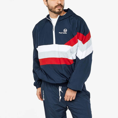 Navy blue anorak featuring white and blue stripes with embroidery logo on the chest.