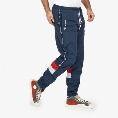 Navy blue sweatpants featuring white and blue stripes with embroidery logo on the side front pocket.