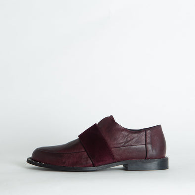 Bordeaux leather shoes with a velvet stripe and tiny studs on the sole.