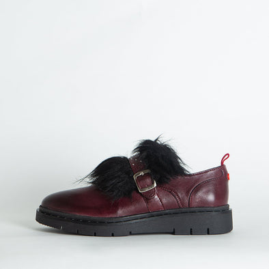 Bordeaux shoes with a tiny strap and black faux-fur.