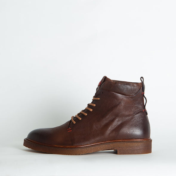 Lace-up brown leather boots.