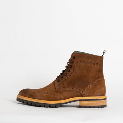 Brown suede boots with track sole.