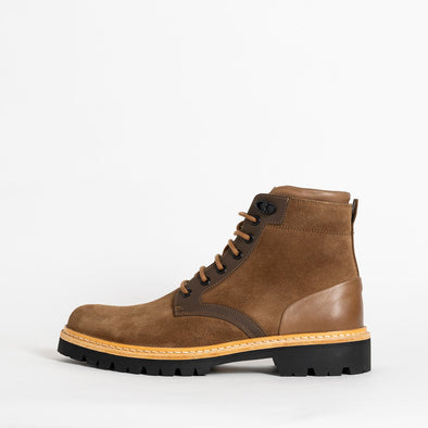 Brown suede boots with leather details and track sole.