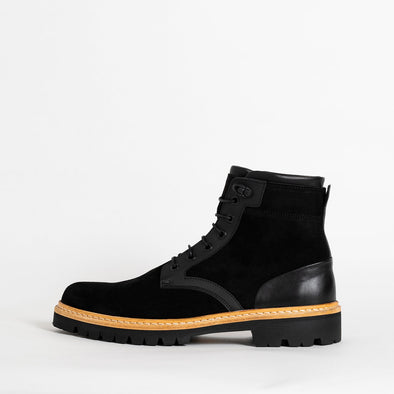 Black suede boots with leather details and track sole.
