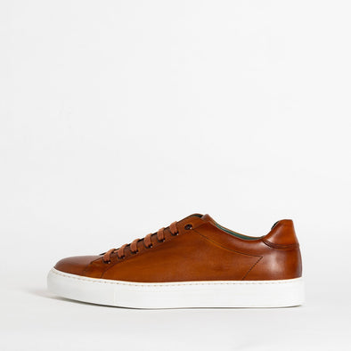 Brown leather low top sneakers.
