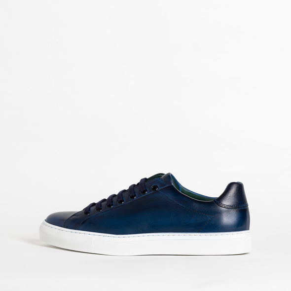 Blue leather low top sneakers.