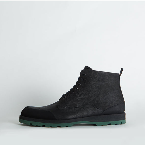 Black lace-up boots with a distinctive sole.