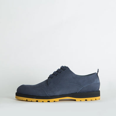 Navy blue derby shoes with a distinctive sole.