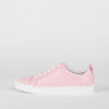 Classic low top leather sneakers in pale pink.