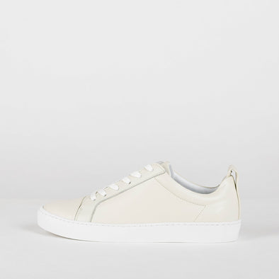 Classic low top leather sneakers in pale white.