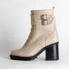 Chunky heeled lace up boots in off-white leather.