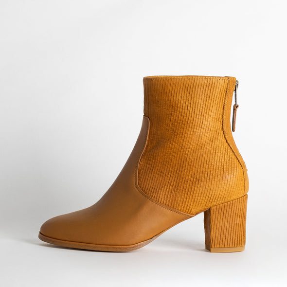 Camel heeled ankle boots in leather and corduroy.