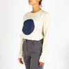 Women's longsleeve with a round neck and blue circle which symbolizes the sun and the cycle of water.