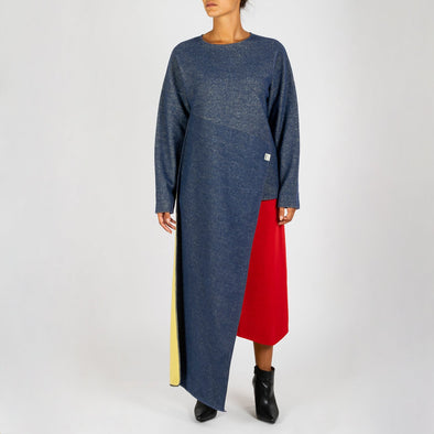 Blue long sleeved knit with assymetrical detail which can be worn as a scarf.