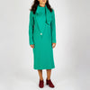 Green long sleeved dress with assymetrical detail.