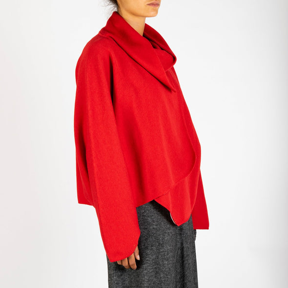 Red bomber with an asymmetric front and an organic design.