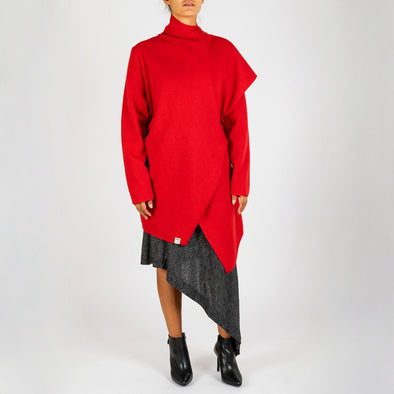 Red coat with an asymmetric front and an organic design.