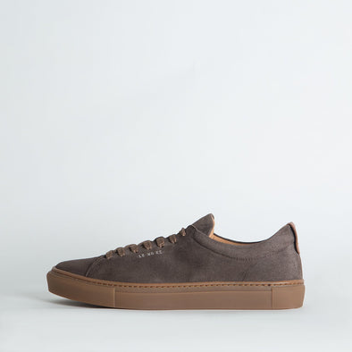 Minimalist low top lace-up sneakers in taupe leather.