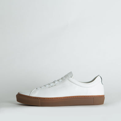 Minimalist low top lace-up sneakers in white leather.