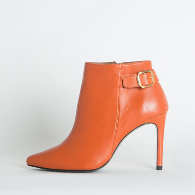 Stiletto boots in orange leather.