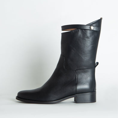 Mid-top black leather boots with a distinct strap.