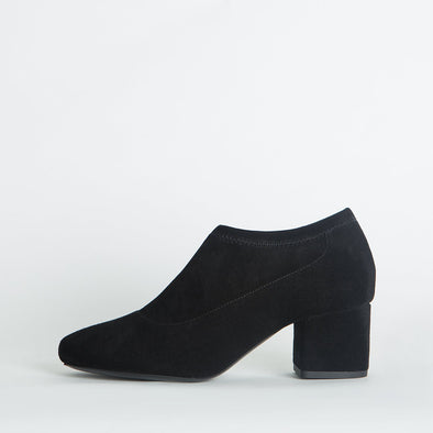 Block heeled ankle boots in black suede.