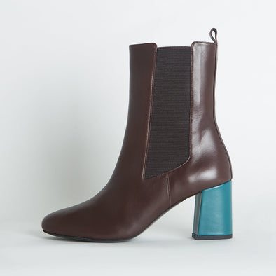 Brown leather chelsea boots with a contrasting blue leather heel.