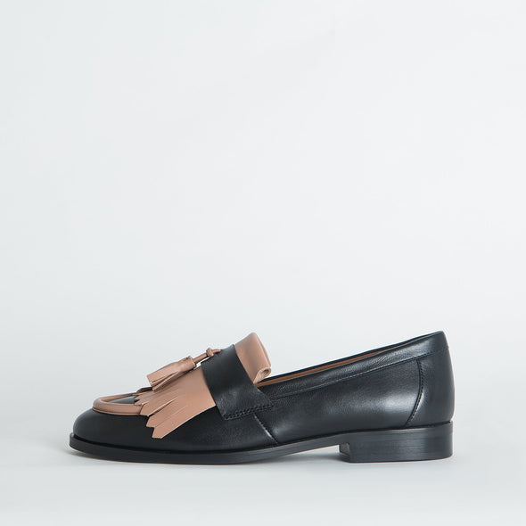 Black leather classic loafers with pops of light pink leather.