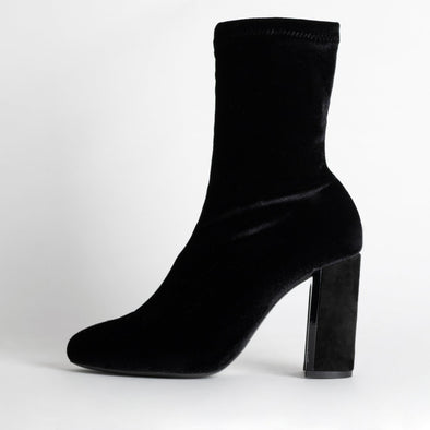 Velvet high heel sock boots in black.
