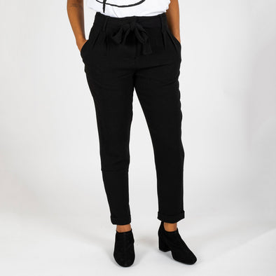 Black high waisted trousers with a belt.
