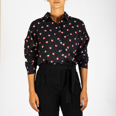 Long sleeved shirt with a rose petal print.