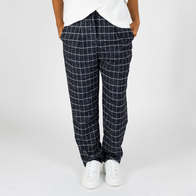 Patterned pleated trousers in navy blue.
