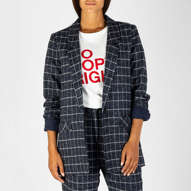 The must-have checked print suit jacket with long sleeves and tailored collar.