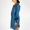 Light and fluid blue shirt dress with white dots, raglan sleeves and wide cuffs.