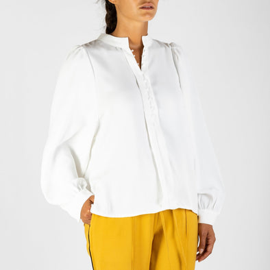 White blouse with long puff sleeves and Tunisian collar.