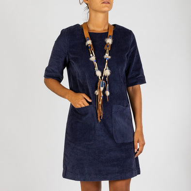 Navy blue corduroy straight dress with short sleeves, round neck and double patch pockets at the thighs.