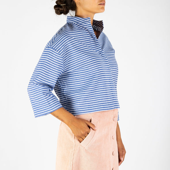 3/4 sleeved striped shirt with a loose fit and a hidden button placket.