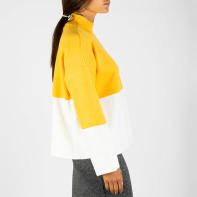 Contrasting yellow and white knit.